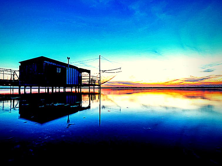 Capanni da pesca al tramonto, un'escursione da non perdere nelle vacanze sul Delta del PO